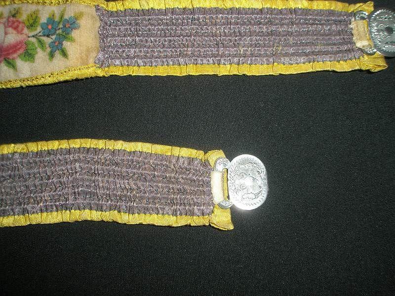 Antique wedding garters showing the metal fastenings