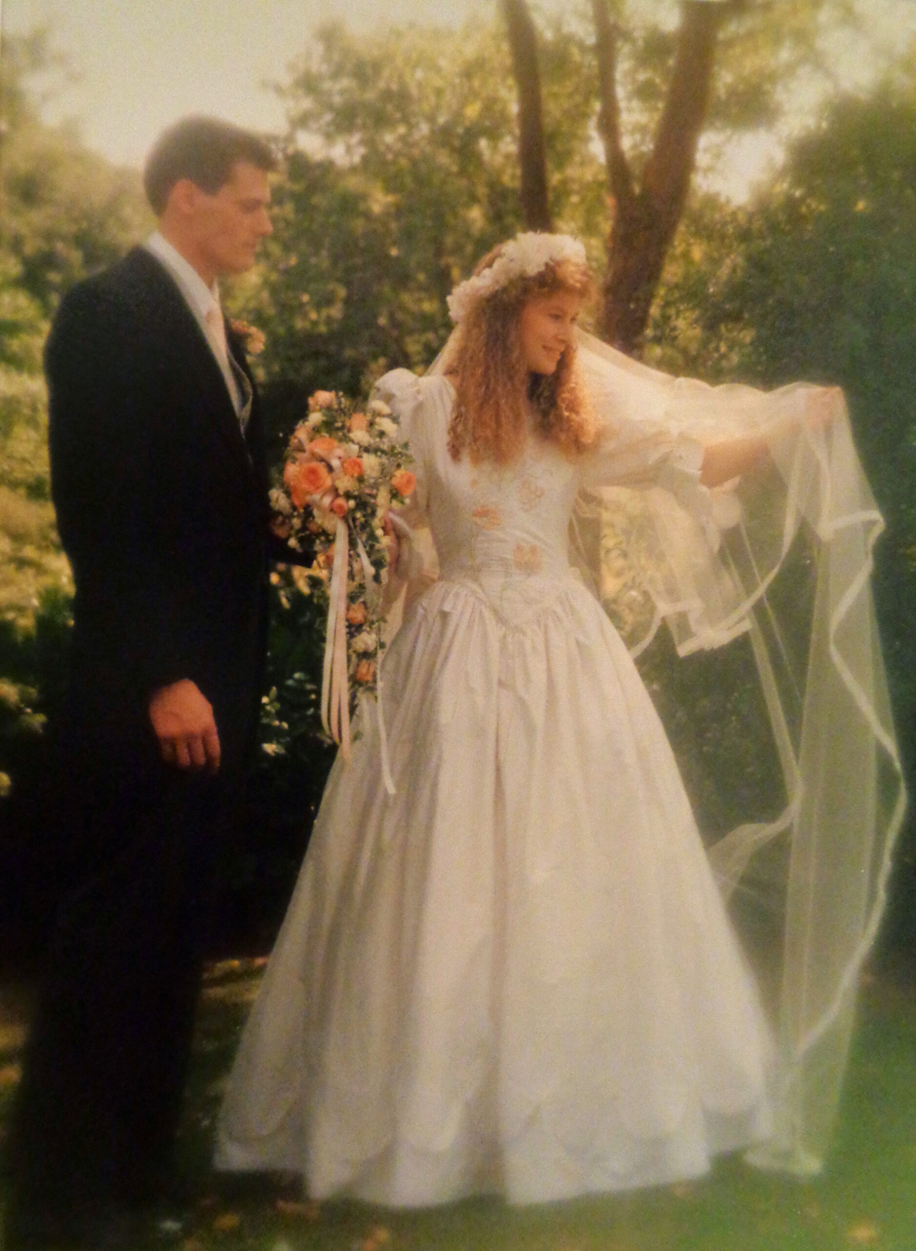 Our wedding, showing off the hand embroidered bodice of my wedding dress