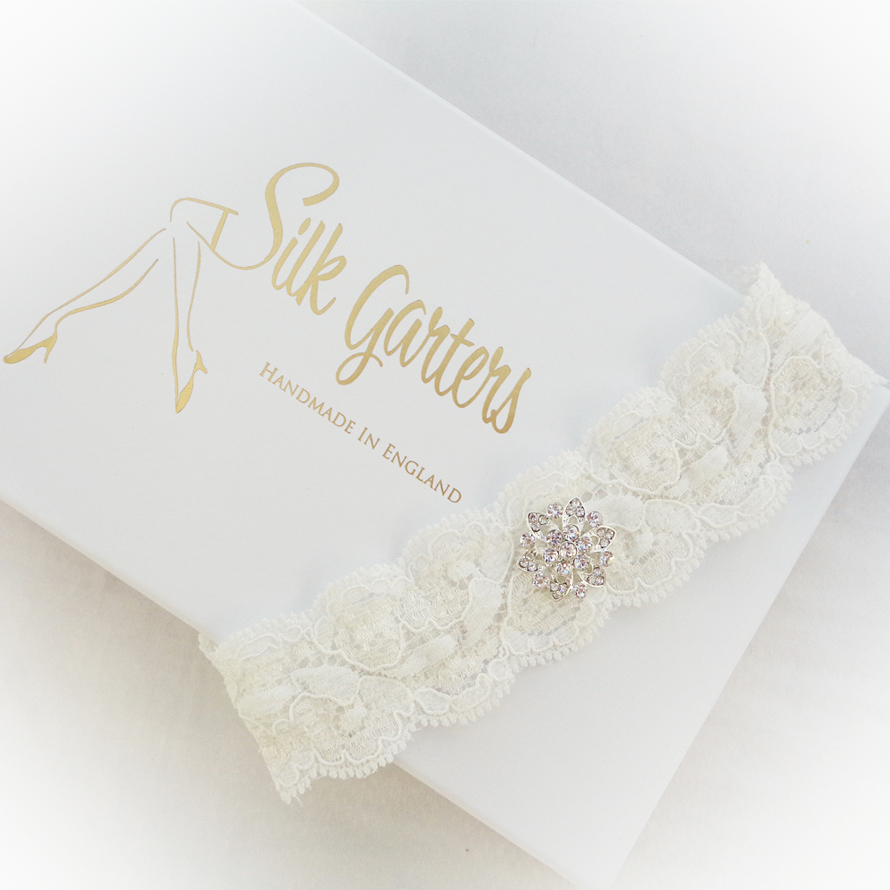 Flat lace wedding garter with secretly hidden elastic to make sure it stays up!