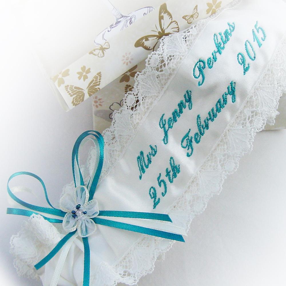 The bride chose a rich teal script for her garter