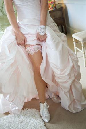 Christine showing her gorgeous pink hand-beaded wedding garter