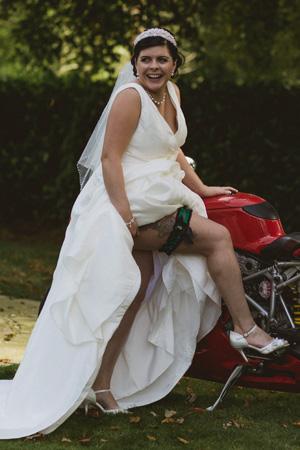 Emma, showing off her custom made Rifles Regiment wedding garter