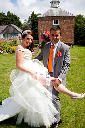 Claire and her new hubby showing off her custom made football garter