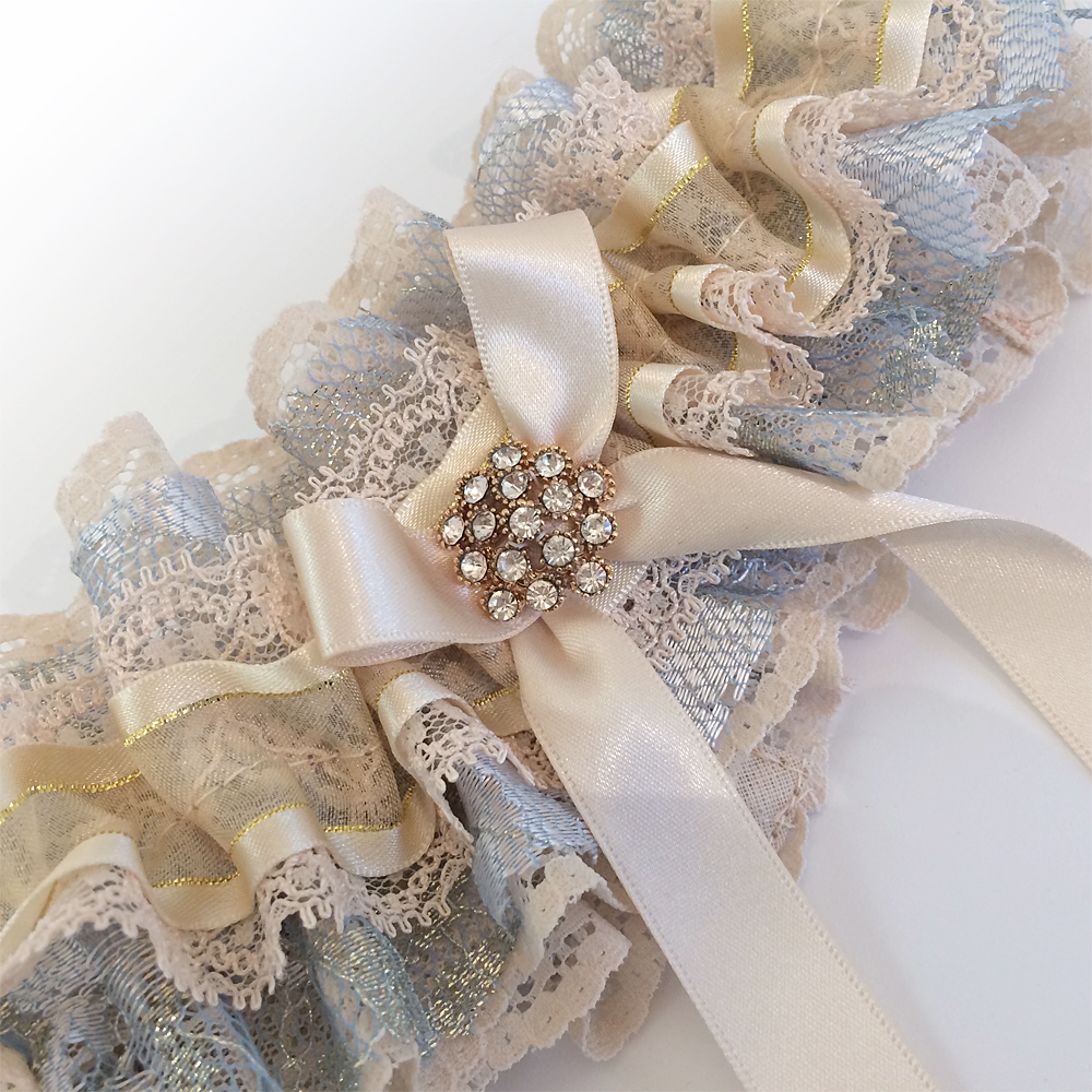 gold and blue wedding garter