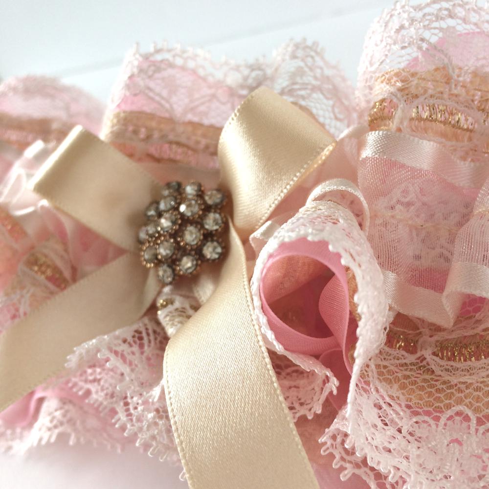 pink and gold wedding garter fairy dust