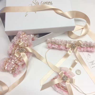Pink and gold wedding garter set fairy dust